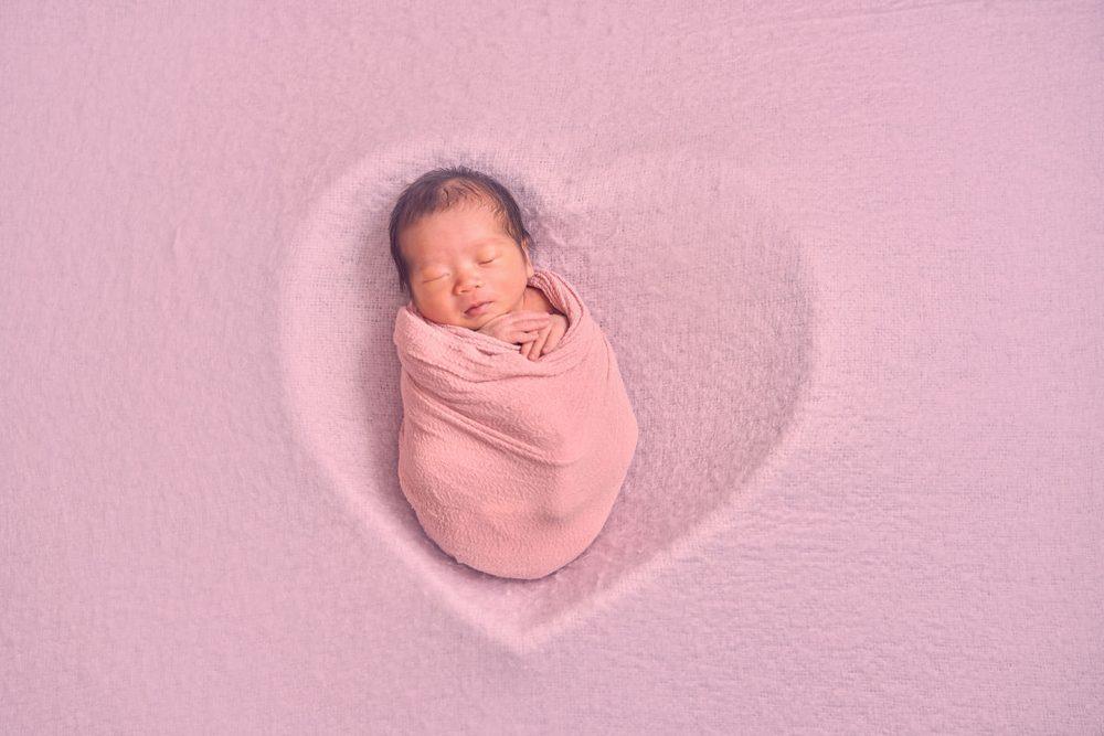 newborn baby girl with props photoshoot